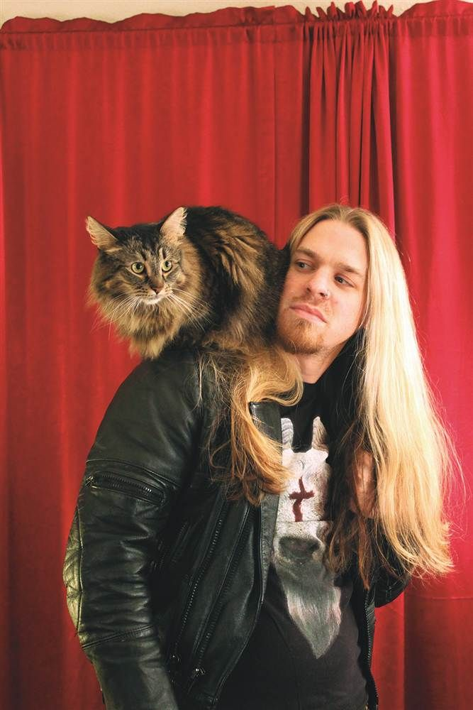 Metal musicians and their cats - Aub Driver of Jahai and Darkhorse Comics holds Freya the cat.