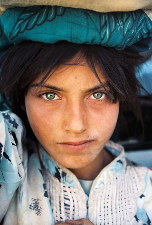 Afghan Girl, Afghanistan, 2002 - This photograph was taken about 30 miles outside of Kabul. Many Afghanis had blue/green eyes such as these. By Jeff Shea