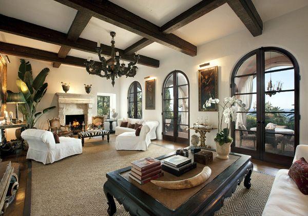 Dark beams, lighter white-grey walls, dark accent furniture, lighter furniture, elaborate ceiling fixtures