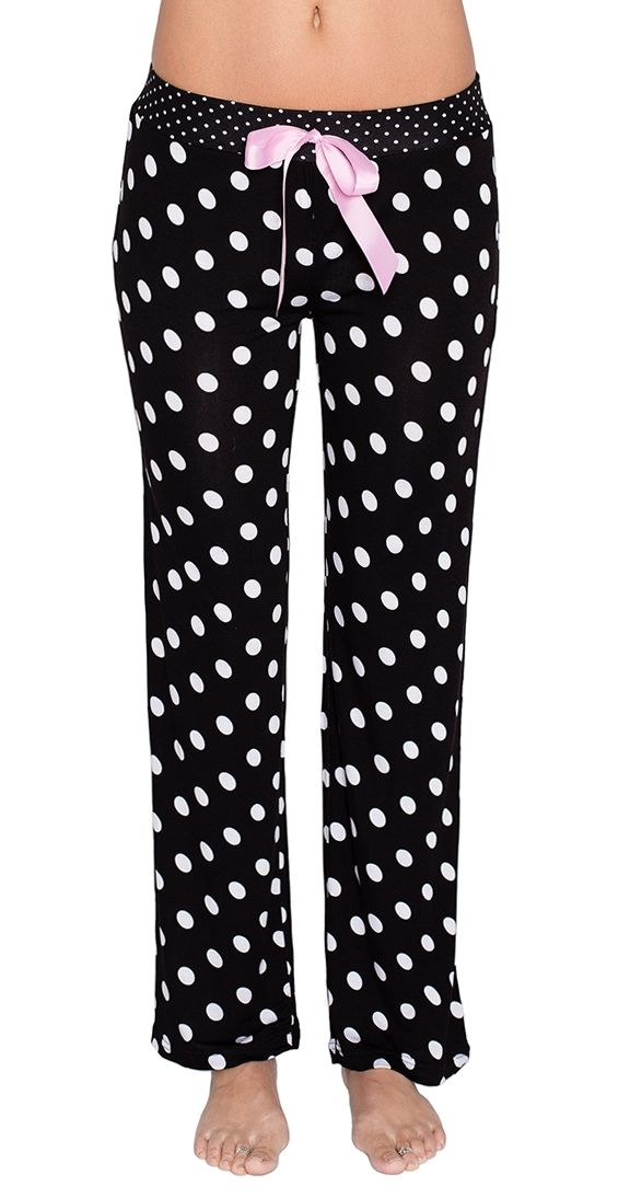 "Save Me a Spot Sleep Pants - black and white polkadot pjs pants. Sweet dreams are almost guaranteed with these fun sleep pants. Soft and comfy, the Save Me a Spot Sleep Pants have an elastic waist and slight stretch. Perfect for sleeping or lounging.  Model is wearing a M Decorative ribbon bow Elastic waist Super soft Rise approx 9.5"" Inseam approx 32"" 95% Rayon 5% Spandex"