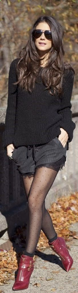 Stylish black sweater, shorts with leggings combination for fall