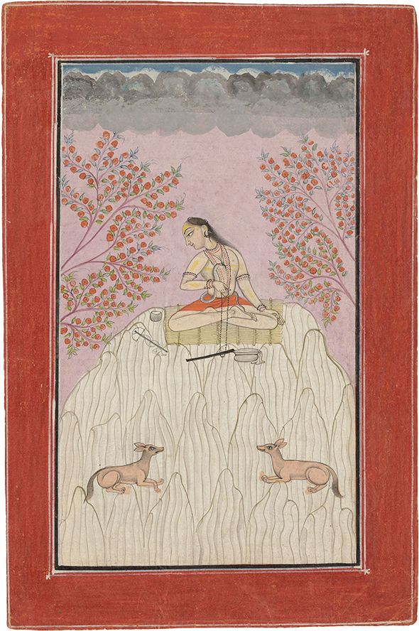 """Hemala Ragaputra of Dipak Raga. Ragamala, Opaque watercolour heightened with gold on paper, India, Bilaspur, 1730-1740, Hemala Ragaputra is shown as a young yogi, perhaps Mahadeva, seated meditating on the summit of a craggy mountain, attended by a pair of confronted jackals who keep watchful guard below him. Mahadeva, meaning """"great god"""", is one of the names of Shiva, who despite his potent destructive powers, also has a benevolent side where he lives the quiet contemplat. life of an…"""