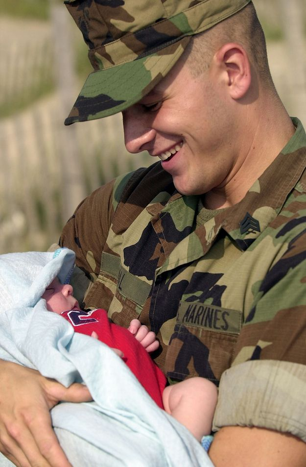 A marine meets his son for the first time