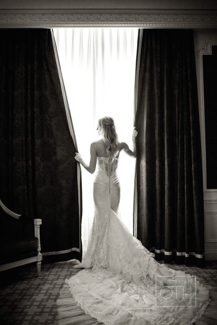 Bride in Lace Gown with Long, Ornate Train | Photography: Christian Oth Studio. Read More: http://www.insideweddings.com/weddings/elaine-alden-and-landry-fields/589/