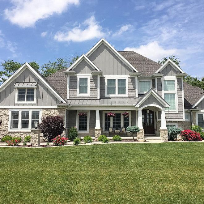 Grey exterior home with grey vinyl shingles and grey board and batten by James…