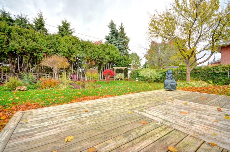 The fenced back yard offers a patio, deck, and mature trees for plenty of privacy on this in-town lot.  #Orangeville #OrangevilleOntario #OrangevilleRealEstate