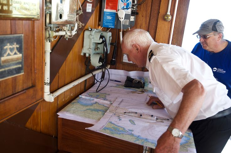 Captain Roy Swan plotting course aboard the historic steam tug William C. Daldy