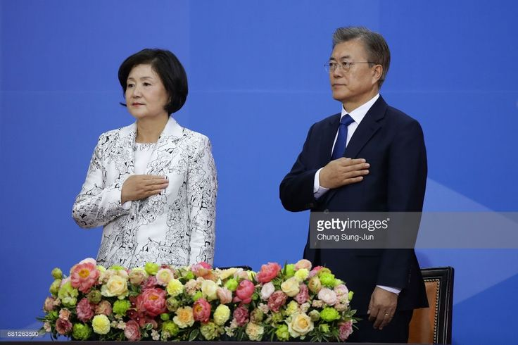 South Korea's new President Moon Jae-In (R) and his wife Kim Jung-Suk salute during the presidential inauguration ceremony at National Assembly on May 10, 2017 in Seoul, South Korea. Moon Jae-in of Democratic Party, was elected as the new president of South Korea in the election held on May 9, 2017.