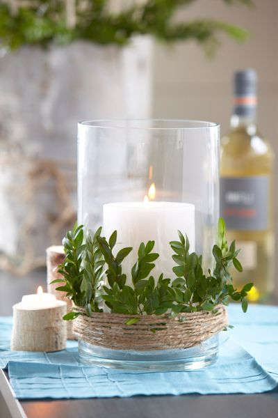 Decorating with Greenery Hurricane Wrapped with Boxwood