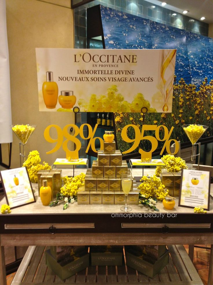 L'Occitane event table using our Long Acrylic Risers
