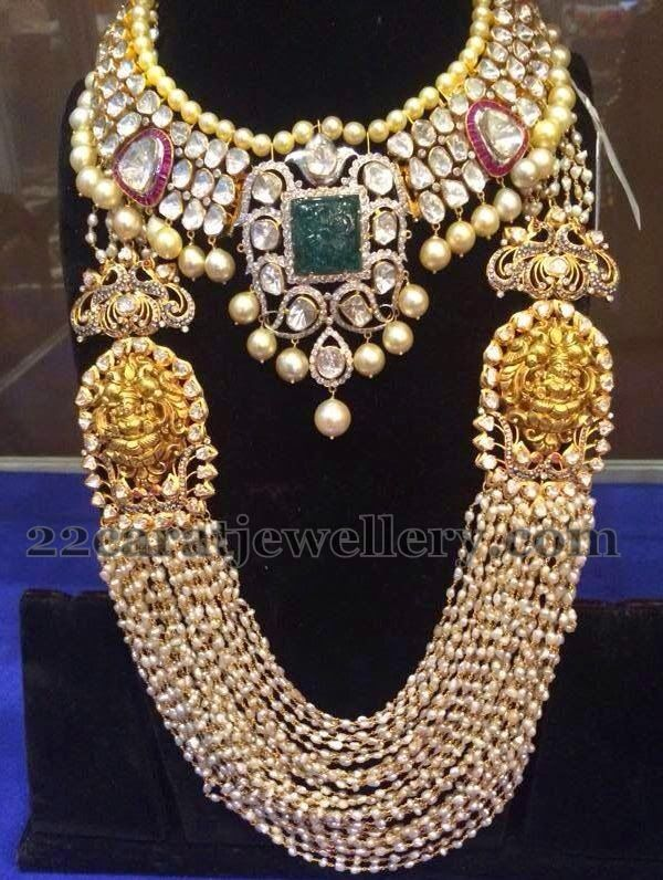 Kundan jadau huge necklace with large square shaped emerald and flat diamonds. South sea pearls hanging in the bottom. Multi strings smal...