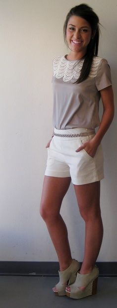 white shorts, grey and cream top and wedges.