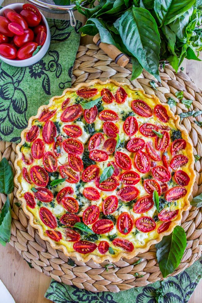 How lovely does this look !Cherry Tomato, Leek, and Spinach Quiche - The Food Charlatan