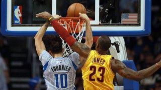NBA Cavs Le Bron James tries to block