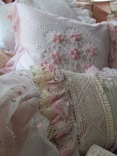 Lovely airy fabrics, lots of lace, ruffles and flowers, pink and white, pillows and bedding, great for shabby chic or cottage (keep the cats off this one!)