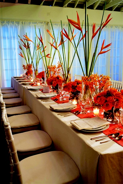 Tall tapered centerpieces are on trend even in the Caribbean.  Sandals® Resorts, WeddingMoons