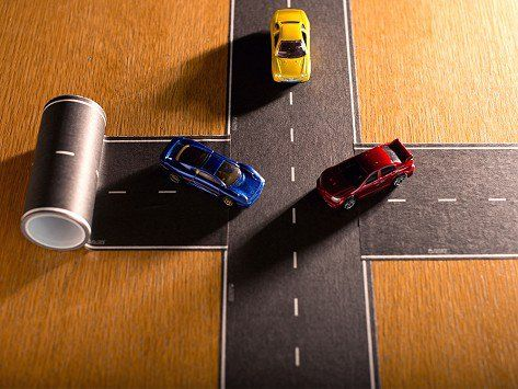 an intersection made with removable playtape diy toy car roads