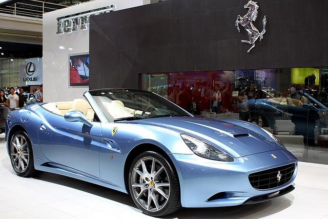 A light blue ferrari california convertible with tan interior for Interior car light laws california