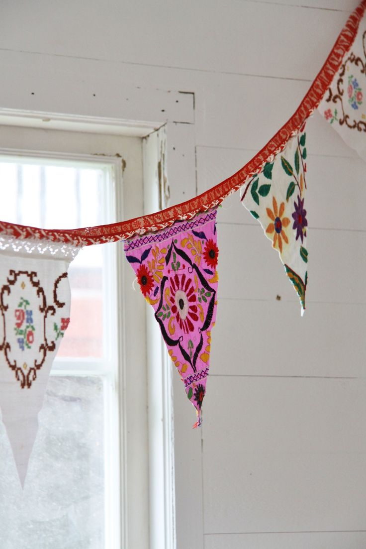 bohemian gypsy flags- create a photo collage of india-inspired fabrics and prints and print onto freezer paper backed muslin. Then just cut squares into triangles and attach to ribbon