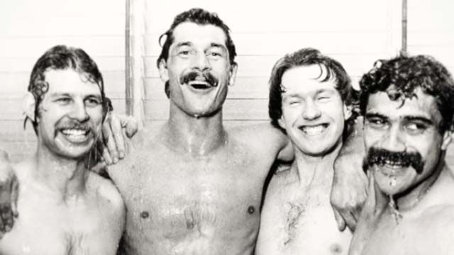 All Blacks in the shower after the third test match against the Wallabies at Eden Park in 1982. The four players were Allan Hewson (fullback), who scored what was then a world record number of points in a test (26), Murray Mexted (no. 8 forward), Stu Wilson (centre) and Bernie Fraser (wing).