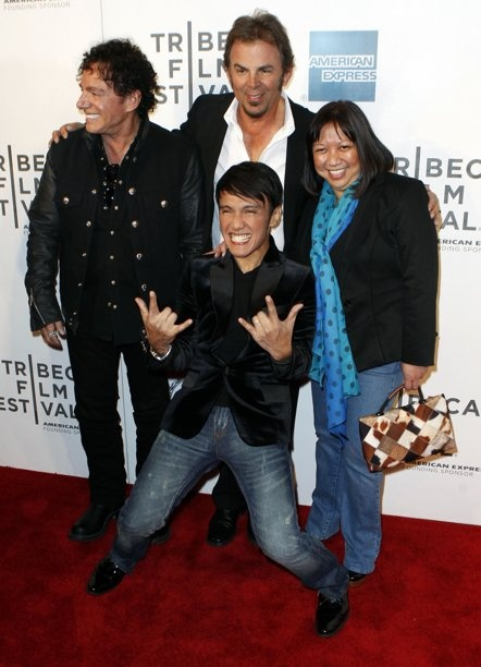 """Singer Arnel Pineda (bottom C), Neal Schon (L), and Jonathan Cain of the band Journey arrive with director Ramona Diaz (R) for the premiere of """"Don't Stop Believin': Everyman's Journey"""" during the 2012 Tribeca Film Festival in New York, April 19, 2012. REUTERS/Lucas Jackson (UNITED STATES - Tags: ENTERTAINMENT)"""