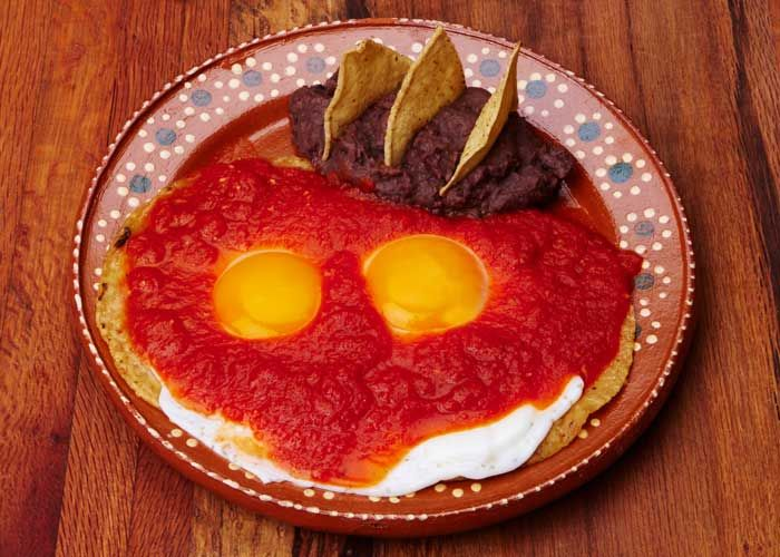 When you need a hearty breakfast, you can't beat Huevos rancheros, a dish prepared with two sunnyside up eggs on fried tortillas covered in a spicy tomato salsa with refried beans on the side. - mexicanfoodjournal.com
