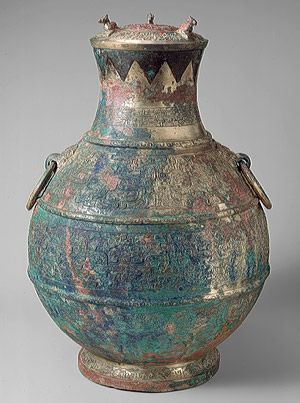"""Wine container (hu), Eastern Zhou dynasty, Spring and Autumn period (770–ca. 475 B.C.), early 5th century B.C.  China  Bronze inlaid with copper  Overall H. 15 3/8 in. (39.1 cm)  Rogers Fund, 1999 (1999.46ab)"""