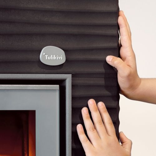 """AALTO 2: The new Aalto 2 fireplace is part of Tulikivi's popular Hiisi product range. The Aalto is an interior designer's dream: its undulating surface can be coloured a tone that matches the room - using a """"Tulikivi Colour' coating."""