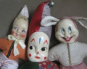Vintage dolls.  I had the clown (in the middle).  Forgot about him until I saw this pin!  I named him David - who knows why!