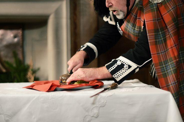 Piper cutting the haggis! Keeping it Scottish!