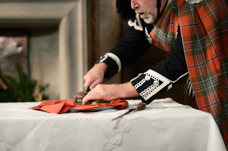 Piper cutting the haggis! Keeping it Scottish!