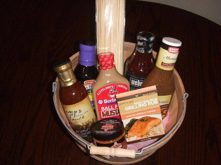 BBQ Gift Basket.  Made this for my boyfriend's parents for their anniversary.  Always nice to try new bbq sauces, and marinades.  Got the basket from Michael's on sale for about three dollars.  In this basket:  stadium mustard, salmon grilling rub, peppercon steak marinade, applewood rub, wooden stewers, weber bbq sauce, terriaki pineapple marinade, sweet sauce marinade.  All in all the basket probably cost me about twenty five bucks to make.  (And his parents loved - bonus!)