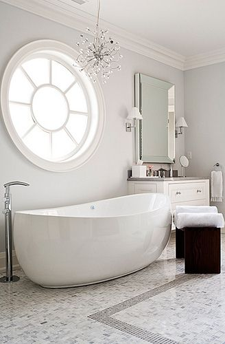 Notice the intricate mosaic work on the flour, and the subtle, egg-like shape of the porcelain free-standing tub. A truly gorgeous bathroom design.