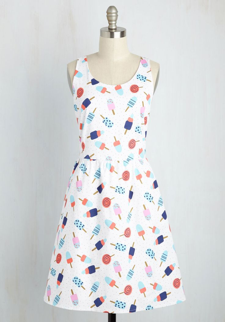 It's so nice to have a dress as darling as this one in your wardrobe! With a crisscrossing back - topped with a bow adornment - and a print of tantalizing ice lollies in blue and bubblegum pink, this fantastic cotton frock offers you the opportunity to greet each day with a grin as bright as your look!