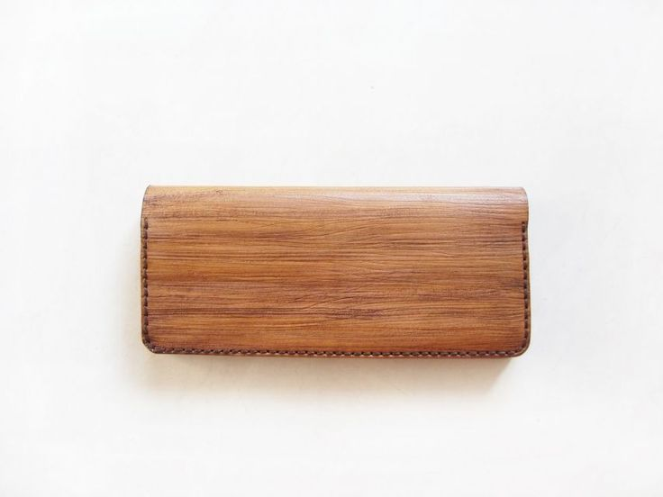 Wood textured purse with12 card slots & 1 large money slot.  Made of genuine vegtan leather. It is 100% handmade. Every single part is hand-cut, hand-painted, hand-carved, and hand-sewn.  Therefore, each product has a distinctive wooden texture and color to one another . It will slowly get darken over time due to exposure to the sun, make it more naturally beautiful.