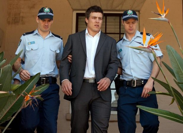 Brax is led away from court.
