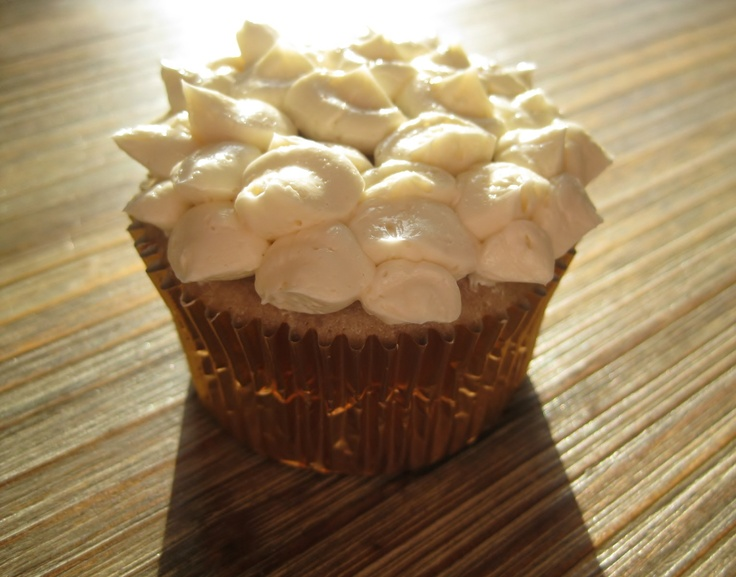 Sparkling Strawberry Cupcake with Petal design basked in sunlight.