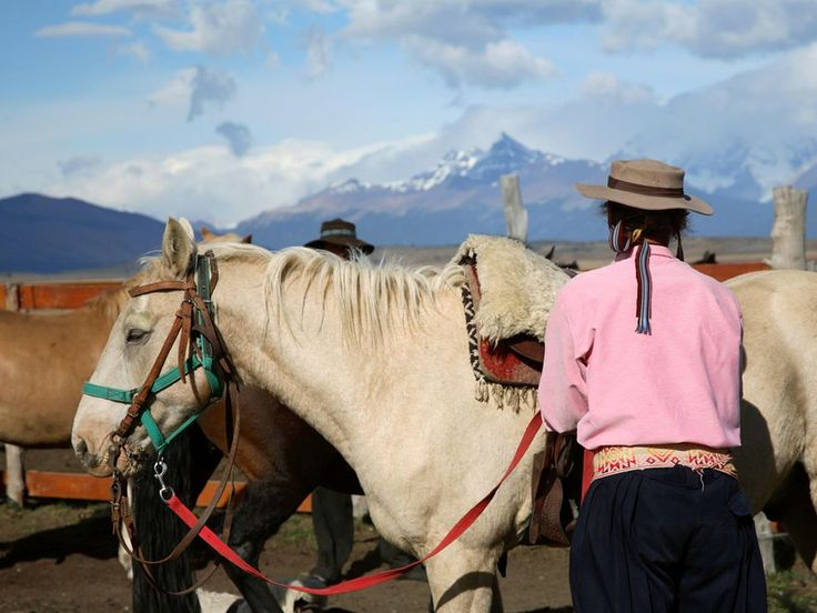 JUNE 15, 2010    Horse Ranch, Argentina  Photograph by Patricia de Solages, My Shot    This Month in Photo of the Day: Travel    Men and horses pause near El Calafate, a town just beyond Lake Argentina in the southern reaches of Patagonia. With its stunning backdrop of Andes peaks, the town is one of the country's biggest tourist draws.