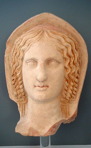 Head of a woman,roman terracotta mid  3rd century BCE,from  Lucerna,votive deposit on the Belvedere hill.  Museo di Archeologia Urbana,Lucerna