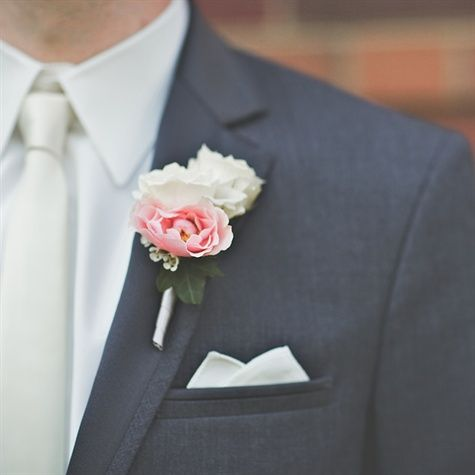 Boutonnieres with Petite pink and white tuberose blooms were backed with ivy leaves.