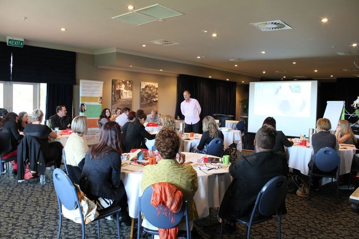 Malcolm Gibbons giving the PowerUP attendees the motivation they need to grow their business success.