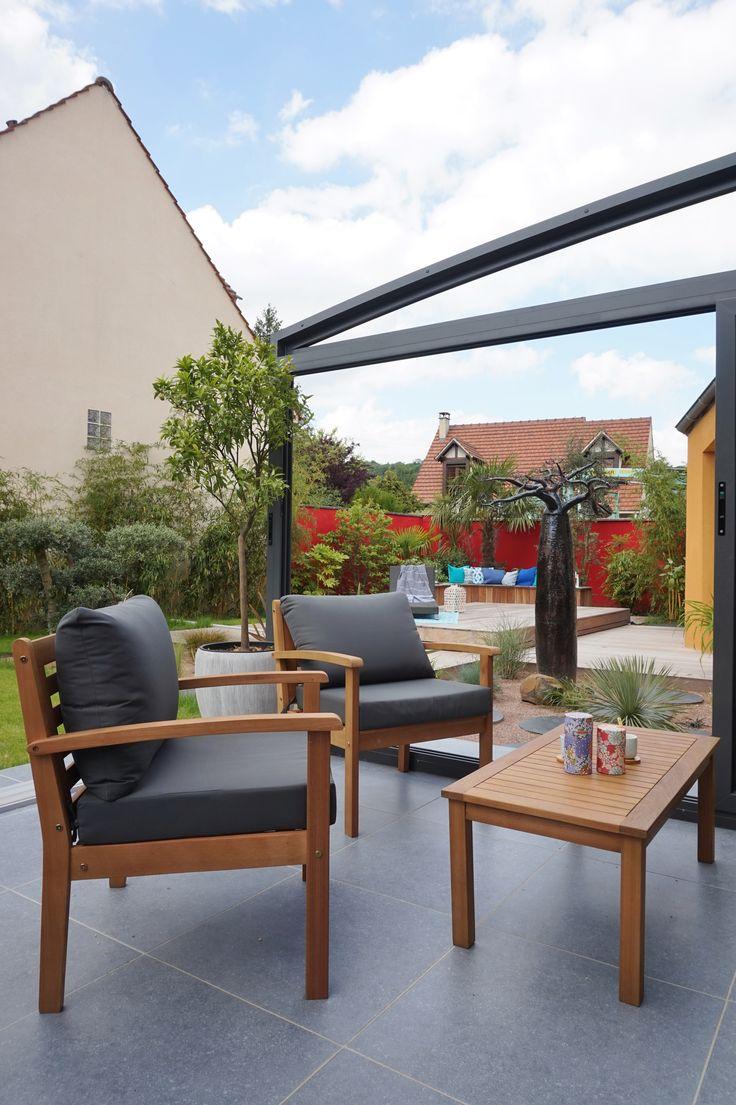 Terrasse moderne et chaleureuse aménagée par l'agence d'architecture ADC l'Atelier d'à côté dans l'Essonne