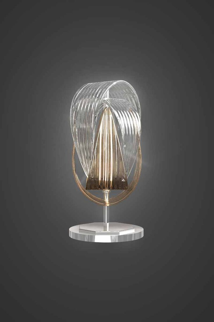 A table lamp from the Babel lighting collection by @jirikrisica. It is made of hand-blown parachute components requiring extraordinary skill and the utmost precision of the glass-maker. The Babel light fixture is attractive as a small or large cluster or a couple of solitary pendants.