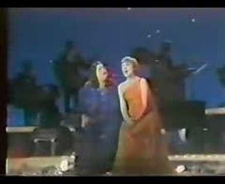 "Mama Cass Elliot & Julie Andrews sing a mdeley of Simon and Garfunkel songs (""Feelin' Groovy"", ""Sounds of Silence"", ""Mrs. Robinson"", ""Scarborough Fair"", ""Homeward Bound"", ""Bridge Over Troubled Water"")"