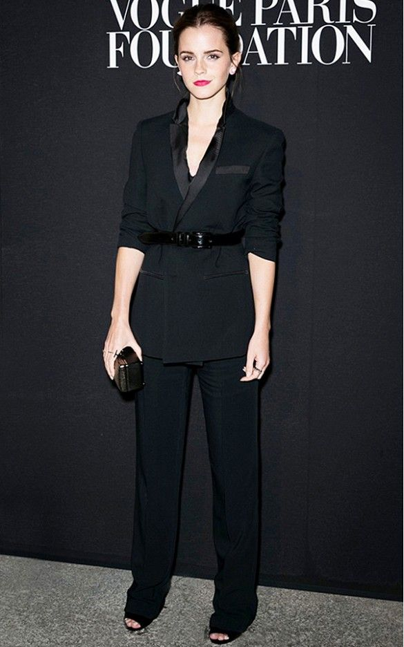 Emma Watson works a masculine edge in this black suit, but offers a feminine twist with a belted waist. // #Fashion
