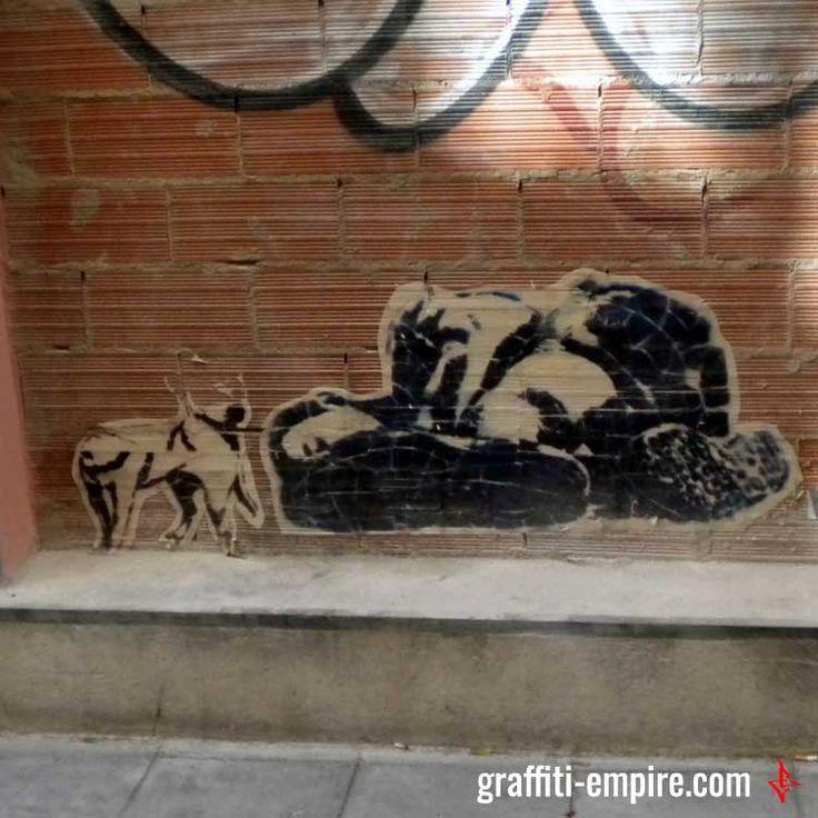 Sleeping dude Stencil Graffiti in Valencia