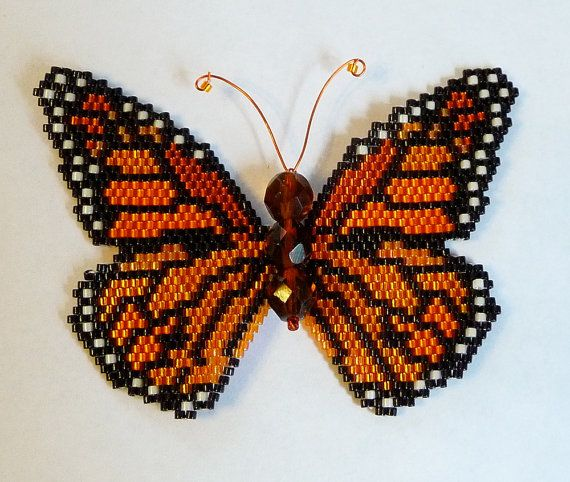 Create a stunning Monarch Butterfly using this 7 page beading pattern and tutorial in pdf format that includes text, photos and illustrations. Using delica cylinder beads, fire polished beads and brick stitch, the finished Monarch Butterfly will be 3 1/4 inches wide (8.4 cm) at its widest point and 2 3/8 inches high (6.0 cm) and may be incorporated into a piece of finished jewelry as you like. To open the file, you will need software that reads pdf format such as Adobe Acrobat Reader.  Note…