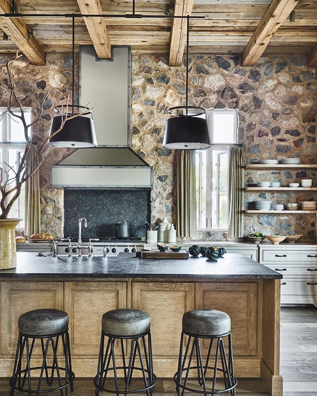 Now THIS is how you do rustic! A salvaged wood ceiling, a stone wall, and a brushed granite countertop come together for an elevated, yet comfortable kitchen that feels like home.⠀ #LuxeAZ Nov/Dec⠀ Interiors: David Michael Miller⠀ Architecture: @phxarch ⠀ Photo: @wernersegarra⠀ @sandow •⠀ •⠀ #instaluxe #rusticdesign #interiors #architecture #stonework #reclaimedwood #brushedgranite #arizonadesign