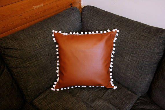 faux leather pillow cover pom poms
