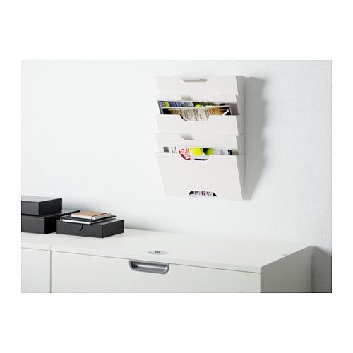 KVISSLE Wall magazine rack  - IKEA $16 each / one for each kid.  Homework in/out / library book & extras?